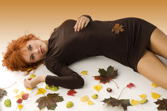 The  fall girl with red hair Royalty Free Stock Photo