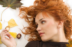 The  fall girl with red hair Royalty Free Stock Image