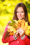 Fall. Girl woman with bunch of autumnal leaves Royalty Free Stock Photos