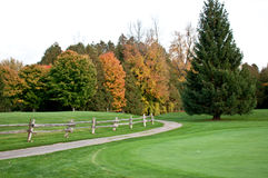 Fall on the golfcourse. With path along side green stock photos