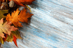 Fall and halloween Background. With pumpkin dry leaves and wood Royalty Free Stock Photography