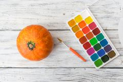 Fall Halloween crafts. One orange decorative pumpkin and bright royalty free stock photos