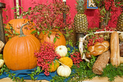 Fall harvest arrangement. A view of a thanksgiving church altar decorated with harvest vegetables Royalty Free Stock Image