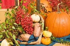 Fall harvest arrangement. A view of a thanksgiving church altar decorated with harvest vegetables Royalty Free Stock Photography