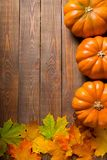 Fall harvest. Autumn pumpkin leaf backgrounds rustic wood stock image