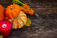 Fall harvest of pumpkins. With candle on wooden table Royalty Free Stock Photography