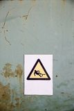 Fall hazard sign on industrial background. Actual fall (trip) hazard sign, symbol warning workers and passers-by of danger and risk of falling, on uniform royalty free stock images