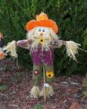 Fall is here. Scarecrow guarding garden, fall decoration Stock Photos