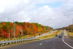 Fall highway. Divided highway with traffic in the fall Stock Photos