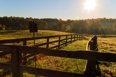 Fall horse farm in Northern Virginia. Morning sun on a horse farm in Northern Virginia, with trees, pasture, grass and fencing Royalty Free Stock Image