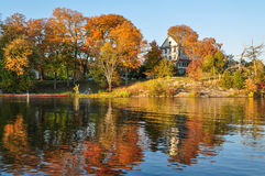 Fall on lake. Fall colors reflecting in the lake water. Cottage in countryside, Ontario, Canada. October stock photos