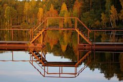 Fall lake and forest. Reflection of a bridge, fall forest and lake Royalty Free Stock Photo