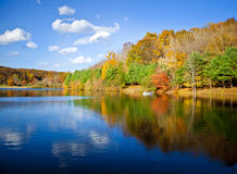 Fall lake. Stunning New England lake in fall with blue sky Royalty Free Stock Photography