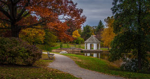 Fall landscape with benches and gazebo in a park Royalty Free Stock Photo