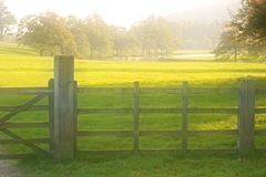 Fall Landscape with Meadw. Soft focus view of meadow and fence in fall stock image