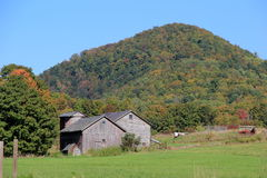 Fall landscape of mountains and farmhouse Stock Image