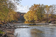 Fall Landscape Scene on a River. Dam in Bernadotte Illinois during the fall with no water on it. On the Spoon River Stock Images