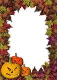 Fall leaves and carved pumpkins forming a frame  Stock Photo