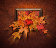 Fall Leaves Coming Out of Antique Frame Royalty Free Stock Photo