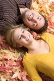 Fall Leaves Couple. Isolated happy smiling fall couple Royalty Free Stock Photo