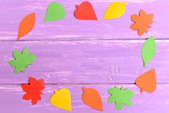 Fall leaves cut from colored paper. Fall background for kids, preschoolers. Top view Royalty Free Stock Photo