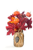Fall Leaves and pumpkins arrangement in a mason jar royalty free stock images
