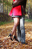 Fall in love. Man and woman embracing each other in the autumn park Stock Images