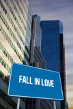 Fall in love against low angle view of skyscrapers Royalty Free Stock Photo