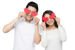 Fall in love concept - young couple holding paper hearts Stock Image