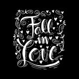 Fall in love. Hand lettering Stock Image
