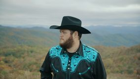 Fall on Max Patch Mountain Appalachian Mountains, Tennessee & North Carolina, portrait of young man in hat, cowboy 4k. Fall on Max Patch Mountain Appalachian stock video
