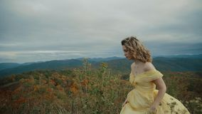 Fall on Max Patch Mountain Appalachian Mountains, Tennessee & North Carolina, portrait of young woman in yellow dress stock footage