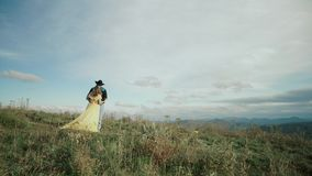 Fall on Max Patch Mountain Appalachian Mountains, Tennessee & North Carolina, young couple, woman in yellow dress. Fall on Max Patch Mountain Appalachian stock video