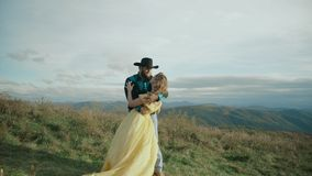 Fall on Max Patch Mountain Appalachian Mountains, Tennessee & North Carolina, young couple, woman in yellow dress. Fall on Max Patch Mountain Appalachian stock video footage