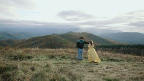Fall on Max Patch Mountain Appalachian Mountains, Tennessee & North Carolina, young couple, woman in yellow dress. Fall on Max Patch Mountain Appalachian stock footage