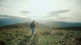Fall on Max Patch Mountain Appalachian Mountains, Tennessee & North Carolina, young couple, woman in yellow dress stock video footage