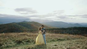 Fall on Max Patch Mountain Appalachian Mountains, Tennessee & North Carolina, young couple, woman in yellow dress stock video