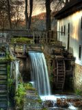 Fall Mill. Old water mill with beautiful sunset light Royalty Free Stock Photo