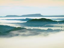 Fall misty valley early morning within sunrise.  Stock Photos