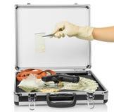 Fall mit Geld und Drogen Stockbild