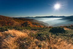 Fall mountain landscape towards the rising sun Royalty Free Stock Image