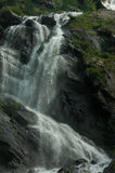 Fall. Mountain waterfall with gray sky Stock Images