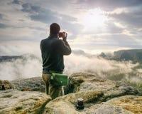 Fall nature photographer prepare camera to takes impressive photos royalty free stock image