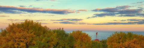 Fall Oakville Sunset Panorama. A fall view of the Oakville lighthouse on Lake Ontario at sunset Royalty Free Stock Images