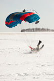 The fall of parachutist in the winter on snow. Stock Photos