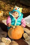 Fall picnic, a child with a pumpkin Royalty Free Stock Images