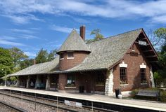 Glencoe Station. This is a Fall picture of the historic METRA Station located in Glencoe, Illinois in Cook County. This brick railroad depot was designed by stock photo