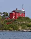 Red Lighthouse. This is a Fall picture of the Marquette Harbor Lighthouse on Lake Superior located in Marquette, Michigan in Marquette County. This painted red royalty free stock images