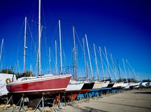 Sailboats In Dry-dock. This is a Fall picture of sailboats in dry-dock for winter storage at Montrose Harbor on Lake Michigan located in Chicago, Illinois in stock images