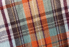 Fall plaid tablecloth. A swatch of fall - orange and brown - plaid cloth Royalty Free Stock Images